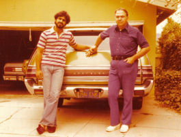 Raffi and Richard with the family station wagon. The license plate reads HAI ENK, meaning